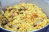 stock photo of cauldron  - Cooked pilaf in big cauldron close up - JPG