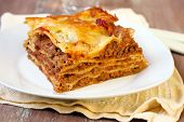 foto of lasagna  - Piece of homemade lasagna on plate selective focus  - JPG