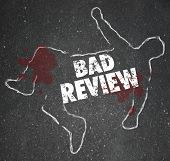stock photo of kill  - Bad Review words on a chalk outline for a dead body of a person killed by negative feedback - JPG