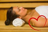 stock photo of sauna  - Peaceful brunette relaxing in a sauna against heart - JPG