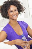 pic of settee  - Beautiful young mixed race black African American woman smiling - JPG