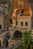 stock photo of chimney rock  - Hotel rooms cut down in the rock in the light of the setting sun - JPG