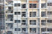 foto of scaffolding  - Construction site of building with scaffolding and tools - JPG