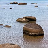 picture of langkawi  - Large boulders on the black sand beach in Langkawi Island - JPG