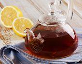 image of teapot  - Glass teapot with tea and fresh lemon - JPG