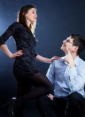 foto of domination  - Scene of a elegant woman dominating her husband - JPG