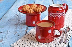 pic of milkman  - Drink brown red old ceramic mug against the milkman and biscuits - JPG