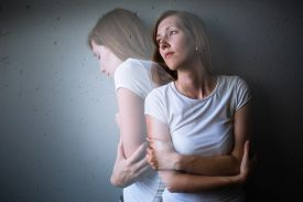 pic of suffering  - Young woman suffering from a severe depression - JPG