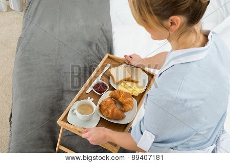 Female Maid With Breakfast Tray