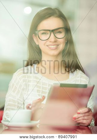 Girl With Digital Tablet In Cafe