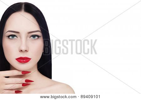 Portrait of young beautiful brunette with red lipstick and long stiletto nails over white background, copy space