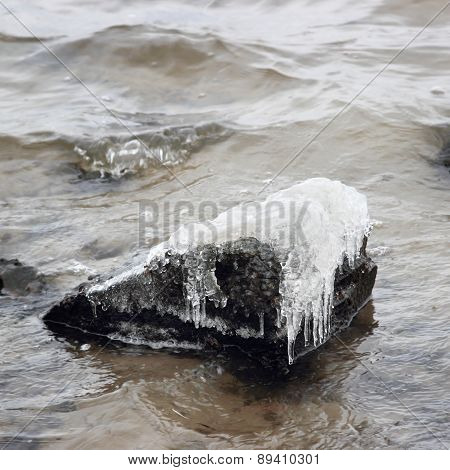 Ice-covered Stone In Water