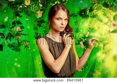 Beautiful young woman  among tropical plants and flowers. Beauty, fashion. Spa, healthcare.