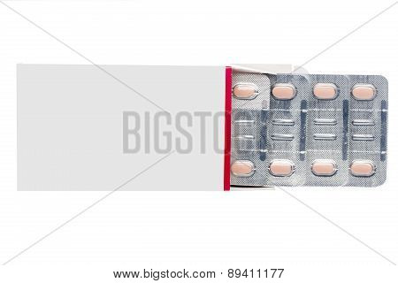 Grey box with pastel pills in a blister pack