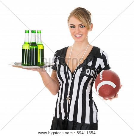 Referee With Drinks And Rugby In Hand