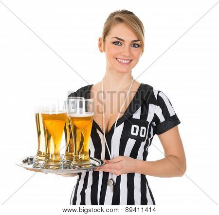 Female Referee With Glass Of Beer
