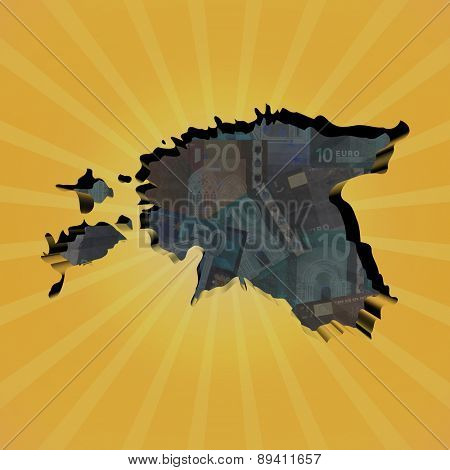 Estonia map on euros sunburst illustration