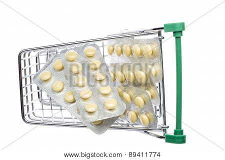 Shop cart with yellow pills blisters