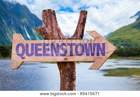 Queenstown wooden sign with mountains background