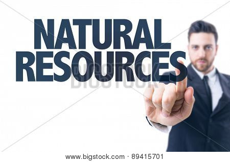 Business man pointing the text: Natural Resources