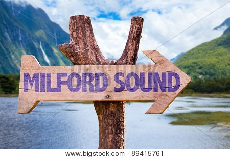 Milford Sound wooden sign with mountains background