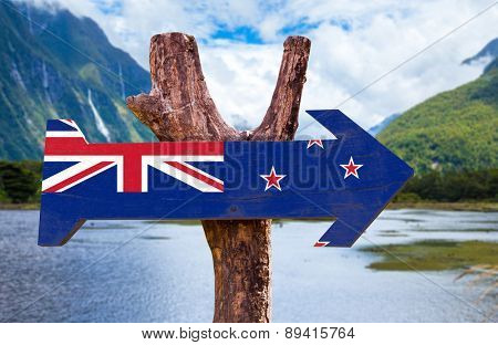 New Zealand Flag wooden sign with mountains background
