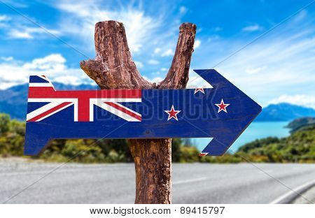 New Zealand Flag wooden sign with road background