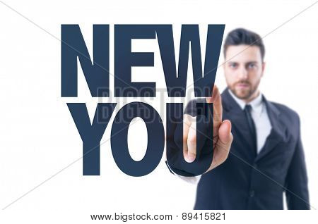 Business man pointing the text: New You