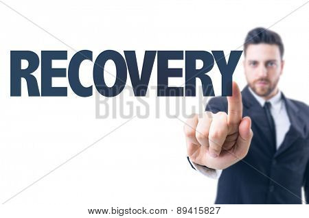 Business man pointing the text: Recovery