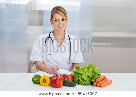 Portrait Of Happy Female Dietician