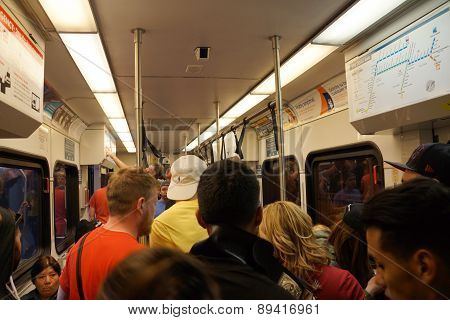 People Stand And Sit Inside A Crowded Vta Train Transit Ride After Wrestlemania 31