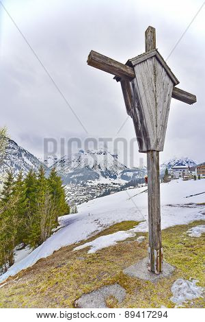 Cross Overlooking The Ski Village Of Lech