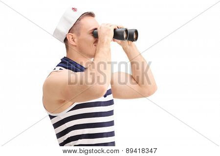 Young male sailor with a striped shirt and a sailors hat looking through binoculars isolated on white background