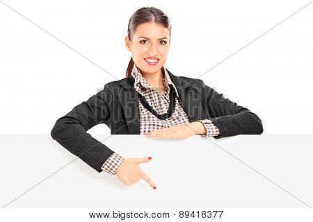 Young beautiful businesswoman pointing on a blank billboard with her finger isolated on white background