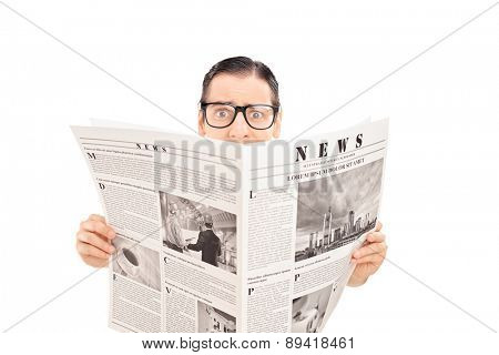 Terrified man holding a newspaper. The newspaper is custom made and the pictures are my copyright.