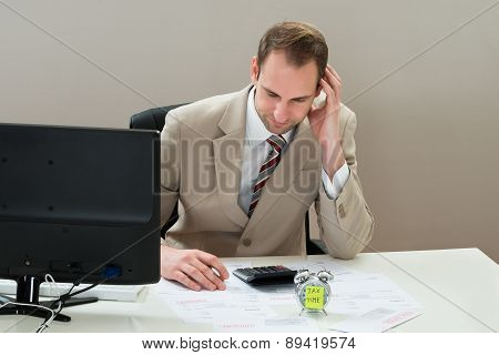Businessman With Envelop And Alarm Clock