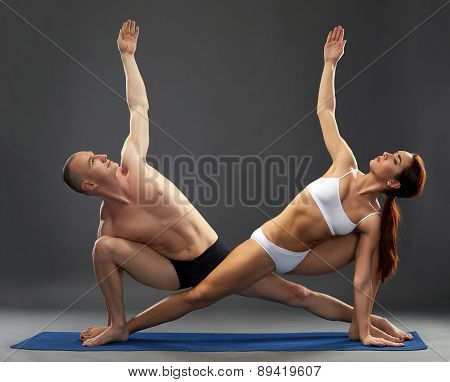 Beautiful composition of yogis, on grey background