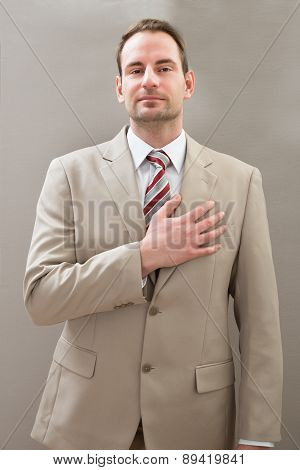 Businessman With Hands On Chest