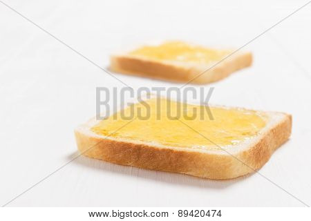 Two slices of bread with honey