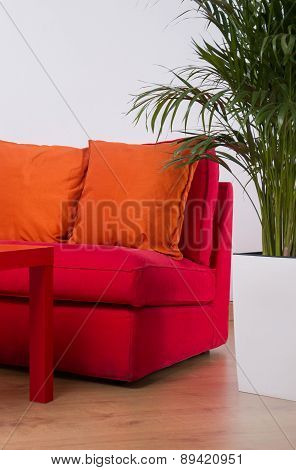 Red Sofa With Orange Cushions