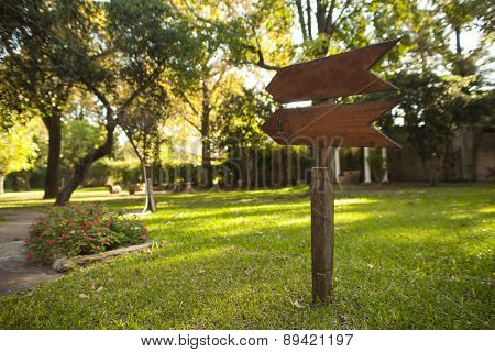 Wooden Garden Sign Pointing Down The Path