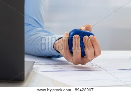 Businesswoman Holding Stress Ball