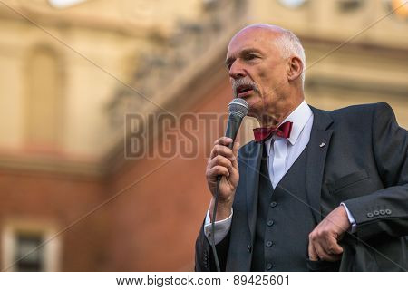 KRAKOW, POLAND - APR 29, 2015: Janusz Korwin-Mikke or JKM, is a conservative liberal Polish politician, during pre-election rally of presidential candidate of Poland, on main square Krakow.