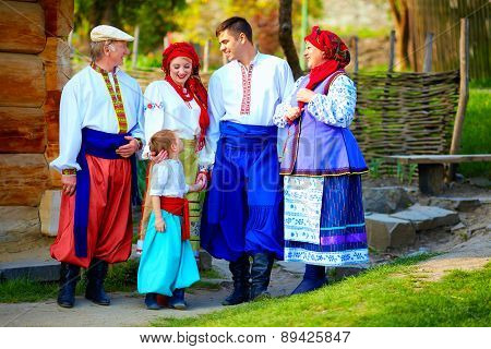 Happy Ukrainian Family In Traditional Costumes On Their Homestead