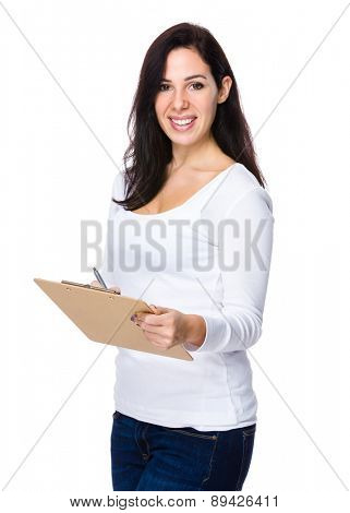 Brunette woman hold with clipboard and pen