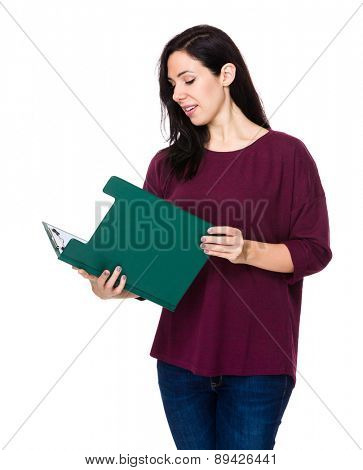 Brunette woman read on clipboard