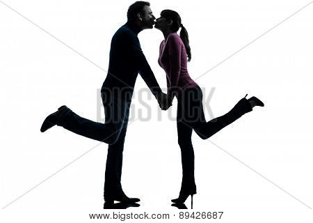 one  couple woman man lovers kissing in silhouette studio isolated on white background