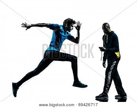 one  man running sprinting with coach stopwatch in silhouette studio isolated on white background