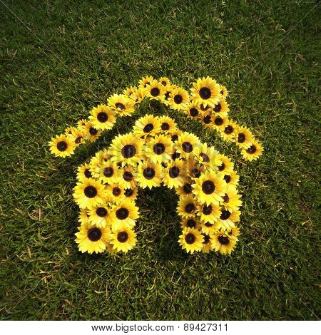 Fresh Spring Sunflowers in the shape of a house