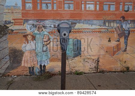 Parking Meter in Front of a Mural